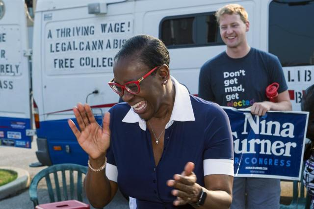 In this July 7, 2021, photo Nina Turner, a candidate running in a special Democratic primary election for Ohio's 11th Congressional District reacts as she speaks with supporters near the Cuyahoga County Board of Elections before casting her vote in Cleveland. (AP Photo/Phil Long)
