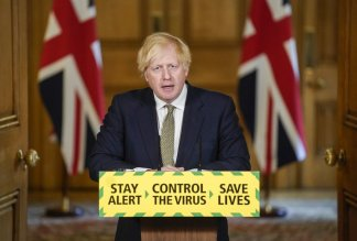United Kingdom leader Boris Johnson stands by aide in lockdown issue