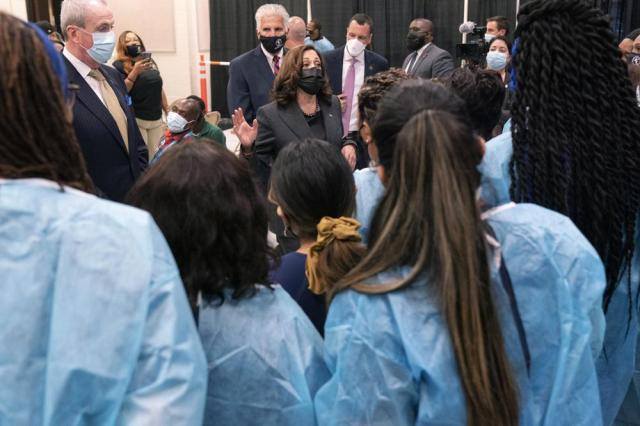 Vice President Kamala Harris talks with people who have been administering COVID-19 vaccinations, in Newark, N.J., Friday, Oct. 8, 2021. (AP Photo/Jacquelyn Martin)