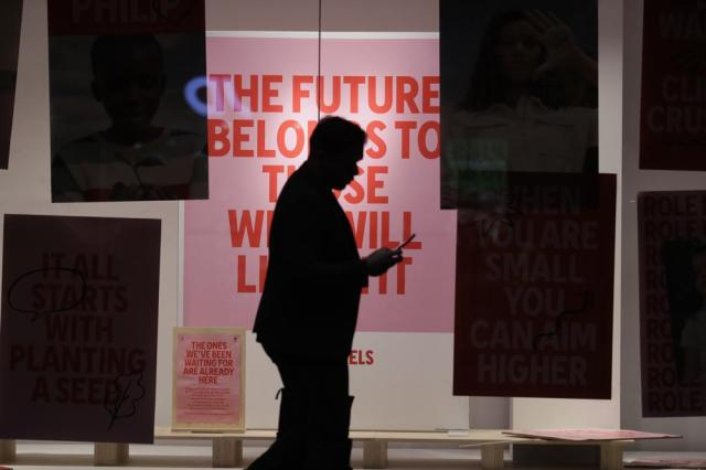 A man walks past a store that begins to open after more than 100 days of lockdown to help contain the COVID-19 outbreak in Sydney, Monday, Oct. 11, 2021. (AP Photo/Rick Rycroft)