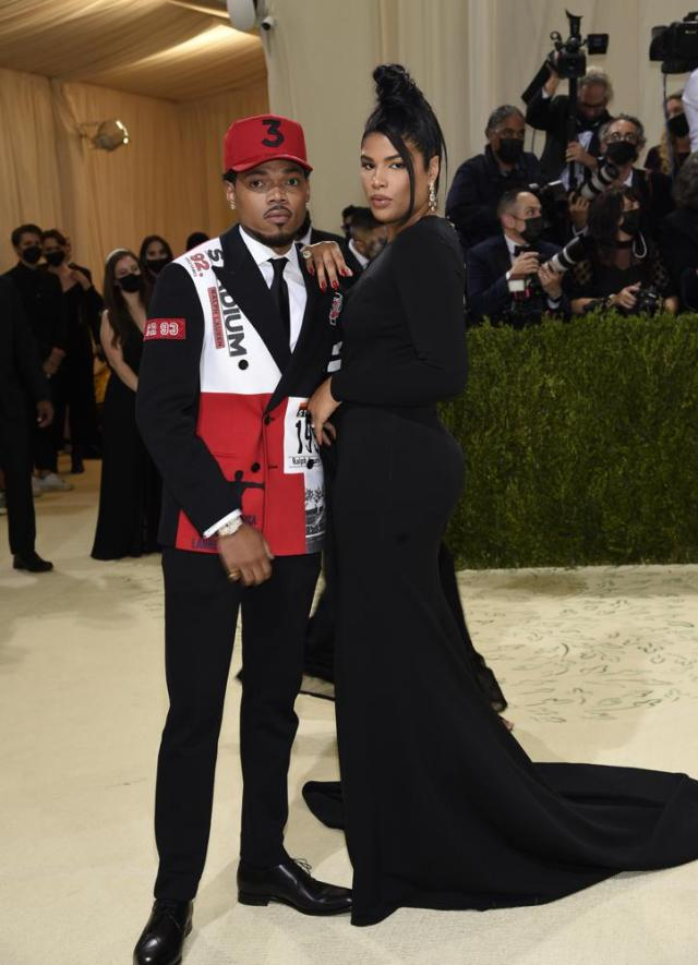 """Chance the Rapper, left, and Kirsten Corley attend The Metropolitan Museum of Art's Costume Institute benefit gala celebrating the opening of the """"In America: A Lexicon of Fashion"""" exhibition on Monday, Sept. 13, 2021, in New York. (Photo by Evan Agostini/Invision/AP)"""