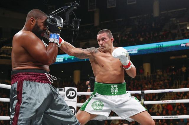 FILE - In this Saturday, Oct. 12, 2019 file photo, Oleksandr Usyk, right, hits Chazz Witherspoon during a heavyweight boxing bout, in Chicago. Usyk is scheduled to take on Anthony Joshua for the heavyweight title, at the London Tottenham Hotspur Stadium next Saturday, Sept. 25. (AP Photo/Kamil Krzaczynski, File)