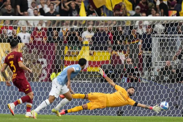 Lazio's Pedro, 2nd left, scores his side's second goal past Roma's goalkeeper Rui Patricio during a Serie A soccer match between Lazio and Roma, at Rome's Olympic Stadium, Sunday, Sept. 26, 2021. (AP Photo/Andrew Medichini)