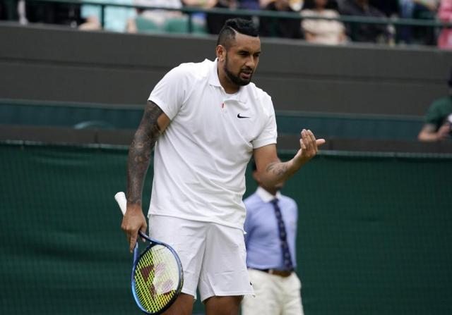 Australia's Nick Kyrgios gestures during the men's singles third round match against Canada's Felix Auger-Aliassime on day six of the Wimbledon Tennis Championships in London, Saturday July 3, 2021. (AP Photo/Alberto Pezzali)