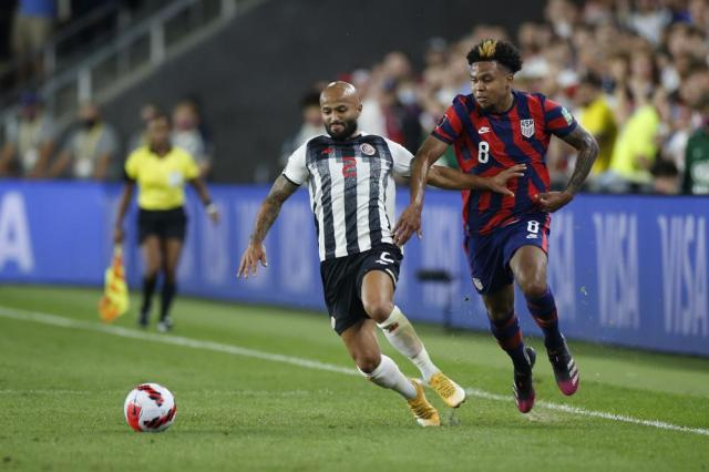 Costa Rica's Ricardo Blanco, left, and United States' Weston McKennie chase the ball during the first half of a World Cup qualifying soccer match Wednesday, Oct. 13, 2021, in Columbus, Ohio. (AP Photo/Jay LaPrete)
