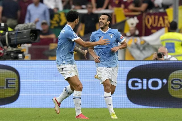 Lazio's Pedro, right, celebrates after scoring his side's second goal during a Serie A soccer match between Lazio and Roma, at Rome's Olympic Stadium, Sunday, Sept. 26, 2021. (AP Photo/Andrew Medichini)