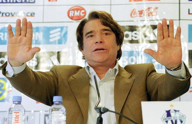 FILE - In this April 9, 2001 file photo Bernard Tapie gestures during a press conference in Marseille, France. Tapie, the charismatic president of French soccer club Marseille during its glory era whose reign was marred by a match-fixing scandal, died Sunday Oct. 3, 2021. He was 78. (AP Photo/Claude Paris, File)