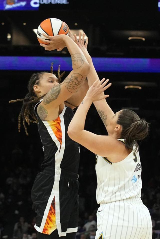 Phoenix Mercury center Brittney Griner (42) shoots over Chicago Sky center Stefanie Dolson during the first half of Game 2 of basketball's WNBA Finals, Wednesday, Oct. 13, 2021, in Phoenix. (AP Photo/Rick Scuteri)