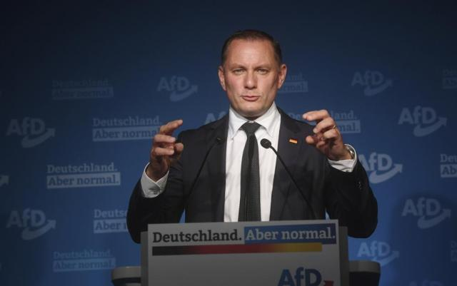 AfD top candidate Tino Chrupalla speaks at the AfD election party after the first forecasts on the outcome of the Bundestag election in Berlin, Sunday, Sept. 26, 2021. Exit polls show the center-left Social Democrats in a very close race with outgoing Chancellor Angela Merkel's bloc in Germany's parliamentary election, which will determine who succeeds the longtime leader after 16 years in power.  (Julian Stratenschulte/dpa via AP)