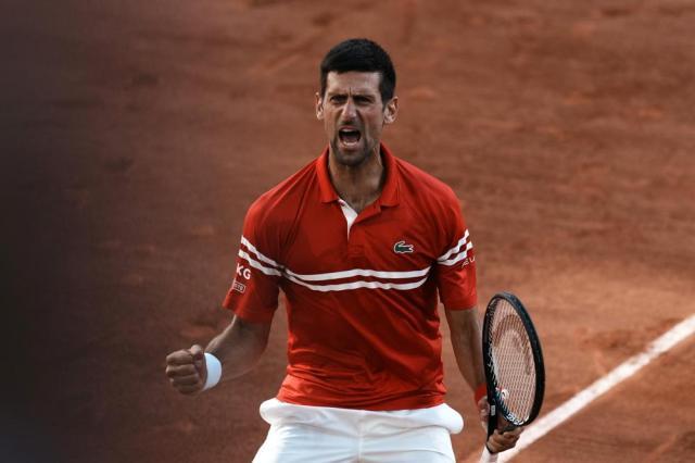 Serbia's Novak Djokovic celebrates defeating Stefanos Tsitsipas of Greece in their final match of the French Open tennis tournament at the Roland Garros stadium Sunday, June 13, 2021 in Paris. Djokovic won 6-7, 2-6, 6-3, 6-2, 6-4. (AP Photo/Thibault Camus)