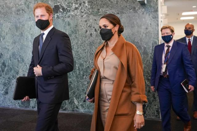 Prince Harry and Meghan, the Duke and Duchess of Sussex are escorted as they leave the United Nations headquarters after a visit during 76th session of the United Nations General Assembly, Saturday, Sept. 25, 2021. (AP Photo/Mary Altaffer)