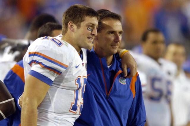 FILE - In this Nov. 1, 2008, file photo, Florida quarterback Tim Tebow, left, and coach Urban Meyer celebrate in the fourth quarter during an NCAA college football game against Georgia in Jacksonville, Fla. Tebow and Meyer are together again, this time in the NFL and with Tebow playing a new position. The former Florida star and 2007 Heisman Trophy-winning quarterback signed a one-year contract with the Jacksonville Jaguars on Thursday, May 20, 2021, and will attempt to revive his pro career as a tight end. (AP Photo/Stephen Morton, File)