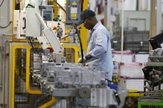 Tens of thousands of auto workers are returning to the factories
