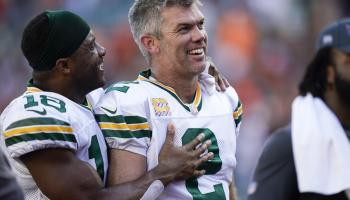 Green Bay Packers kicker Mason Crosby (2) is congratulated by wide receiver Randall Cobb (18) after kicking the winning field goal during overtime in an NFL football game against the Cincinnati Bengals in Cincinnati, Sunday, Oct. 10, 2021. The Packers defeated the Bengals 25-22 in overtime. (AP Photo/Bryan Woolston)