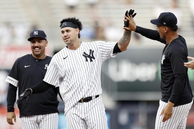 New York Yankees' Gary Sanchez, center, is congratulated after hitting a walkoff single against the Minnesota Twins during the 10th inning of a baseball game on Monday, Sept. 13, 2021, in New York. (AP Photo/Adam Hunger)