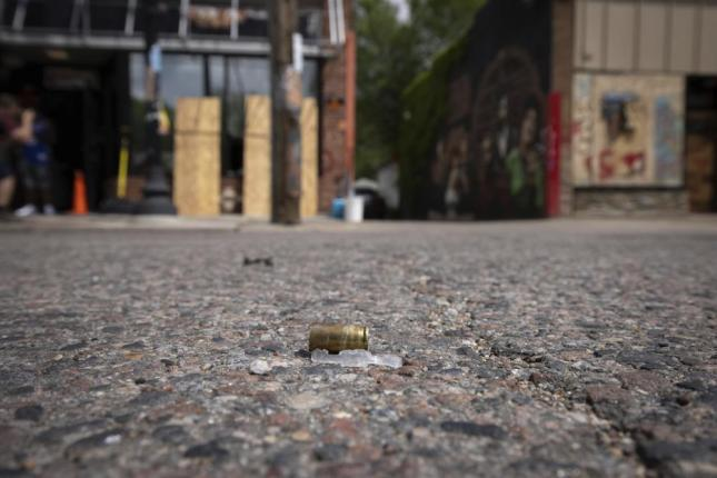 A bullet casing is seen after shots were fired in George Floyd Square on the one year anniversary of George Floyd's death on Tuesday, May 25, 2021, in Minneapolis.  The intersection where George Floyd died was disrupted by gunfire Tuesday, just hours before it was to be the site of a family-friendly street festival marking the anniversary of his death at the hands of police.(AP Photo/Christian Monterrosa)