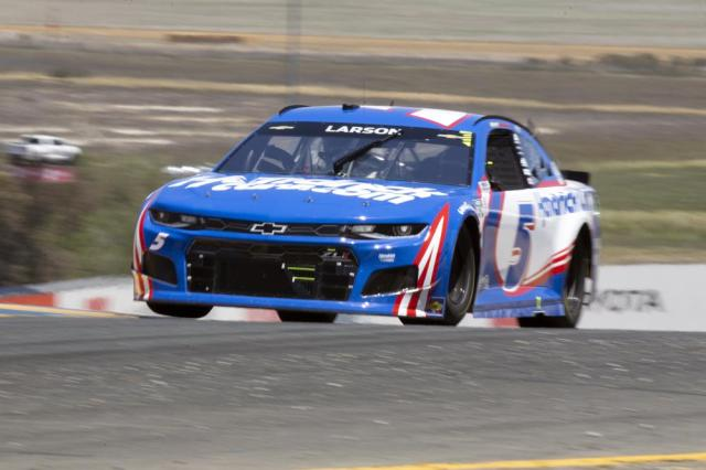 Kyle Larson speeds through turn 2 during a NASCAR Cup Series race, Sunday, June 6, 2021, at Sonoma Raceway in Sonoma, Calif. Larson won the first and second stages of the 350-mile race. (AP Photo/D. Ross Cameron)
