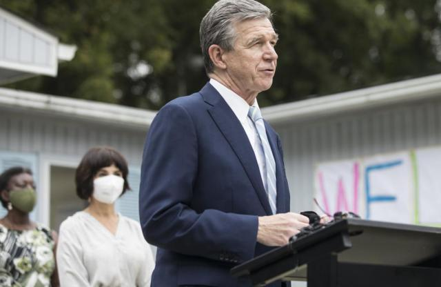 Gov. Roy Cooper speaks during a press conference at the Community School for People Under Six in Carrboro, N.C. on Thursday, Oct. 7, 2021. (Julia Wall/The News & Observer via AP)
