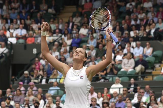 Czech Republic's Karolina Pliskova celebrates after defeating Switzerland's Viktorija Golubic during the women's singles quarterfinals match on day eight of the Wimbledon Tennis Championships in London, Tuesday, July 6, 2021. (AP Photo/Alberto Pezzali)