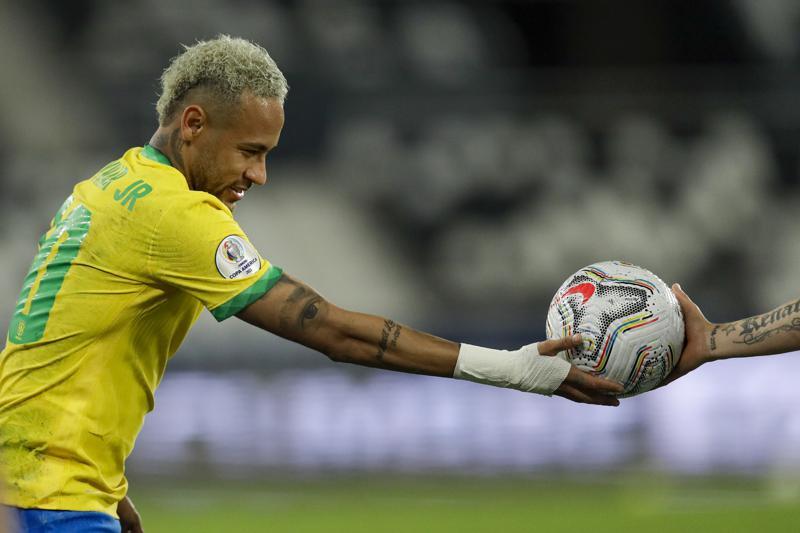 Brazil's Neymar receives the ball from a Chilean player during a Copa America quarterfinal soccer match at the Nilton Santos stadium in Rio de Janeiro, Brazil, Friday, July 2, 2021. (AP Photo/Bruna Prado)