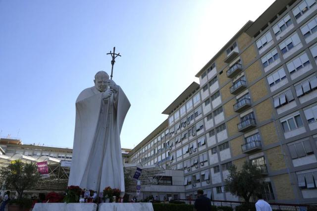 The statue of Pope John Paul II is seen at the entrance of the Agostino Gemelli Polyclinic in Rome, Wednesday, July 7, 2021, where Pope Francis was hospitalized Sunday. (AP Photo/Alessandra Tarantino)