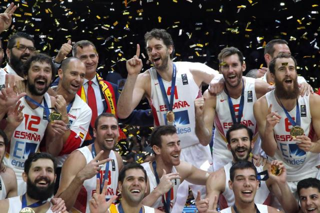 FILE - Pau Gasol of Spain, standing center, celebrates with teammates and King Felipe VI of Spain, fourth right, after winning the EuroBasket European Basketball Championship final match against Lithuania at the Pierre Mauroy stadium in Lille, northern France, in this Sunday, Sept. 20, 2015, file photo. Pau Gasol announced his retirement from basketball on Tuesday,  Oct. 5, 2021, ending a career that lasted more than two decades and earned him two NBA titles and a world championship gold with Spain's national team.(AP Photo/Michel Euler, File)