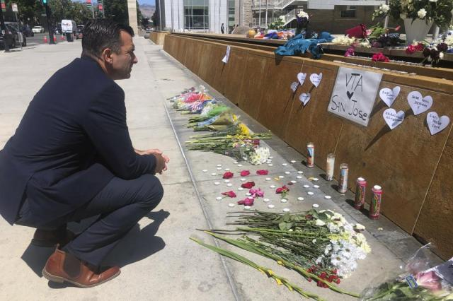 San Jose Mayor Sam Liccardo stops to view a makeshift memorial for the rail yard shooting victims in front of City Hall in San Jose, Calif., on Thursday, May 27, 2021. An employee opened fire Wednesday at a California rail yard, killing eight people before taking his own life as law enforcement rushed in, authorities said, marking the latest attack in a year that has seen a sharp increase in mass killings as the nation emerges from coronavirus restrictions. (AP Photo/Haven Daley)