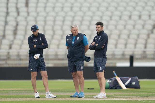 England's captain Joe Root, left, coach Chris Silverwood, center, and bowler James Anderson look at the pitch during a nets session before the 5th Test cricket match between England and India at Old Trafford cricket ground in Manchester, England, Thursday, Sept. 9, 2021. (AP Photo/Jon Super)