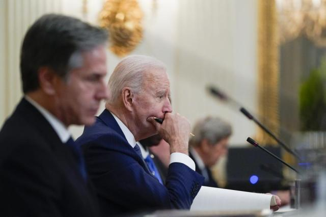 President Joe Biden attends a meeting with South Korean President Moon Jae-in, in the State Dinning Room of the White House, Friday, May 21, 2021, in Washington. Secretary of State Antony Blinken is at left. (AP Photo/Alex Brandon)