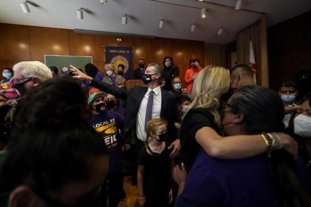 Gov. Gavin Newsom, middle, gestures toward supporters with his daughter, Brooklynn, after speaking to volunteers in San Francisco, Tuesday, Sept. 14, 2021. The recall election that could remove California Democratic Gov. Newsom is coming to an end. Voting concludes Tuesday in the rare, late-summer election that has emerged as a national battlefront on issues from COVID-19 restrictions to climate change. (AP Photo/Jeff Chiu)