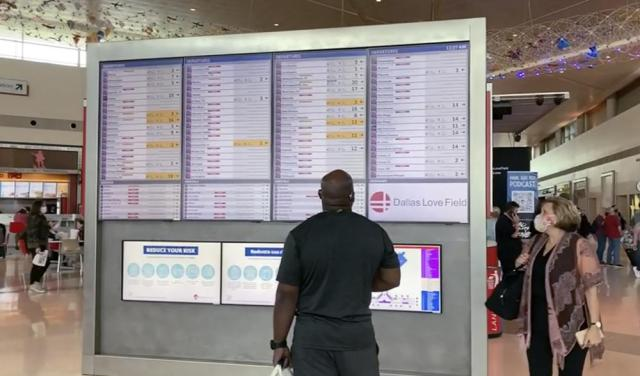 In this frame grab from cellphone video, passengers look for information on their flights, Sunday, Oct. 10, 2021, at Dallas Love Field. Southwest Airlines canceled hundreds of flights over the weekend, blaming the woes on air traffic control issues and weather. (AP Photo/Julie March)