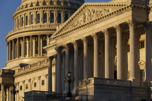 """The Senate side of the Capitol is seen at dawn as a consequential week begins in Washington for President Joe Biden and Democratic leaders in Congress who are trying to advance his $3.5 trillion """"Build Back Better"""" and pass legislation to avoid a federal shutdown, Monday, Sept. 27, 2021. (AP Photo/J. Scott Applewhite)"""