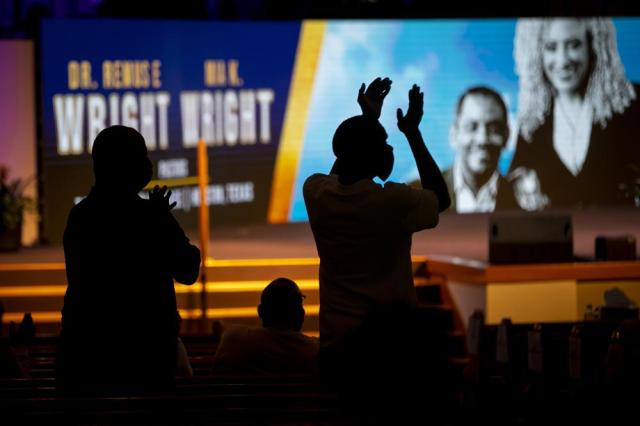 Audience members clap during a commemorative concert hosted by the George Floyd Foundation at The Fountain of Praise church on Sunday, May 30, 2021, in Houston. Musicians, elected officials and community members joined the family of George Floyd to reflect on his life and the year of fighting for social justice since his murder. (Annie Mulligan/Houston Chronicle via AP)