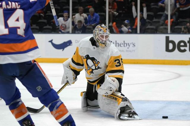 Pittsburgh Penguins goaltender Tristan Jarry (35) reacts as he looks at the puck shot by New York Islanders' Ryan Pulock for a goal during the second period of Game 6 of an NHL hockey Stanley Cup first-round playoff series, Wednesday, May 26, 2021, in Uniondale, N.Y. (AP Photo/Frank Franklin II)