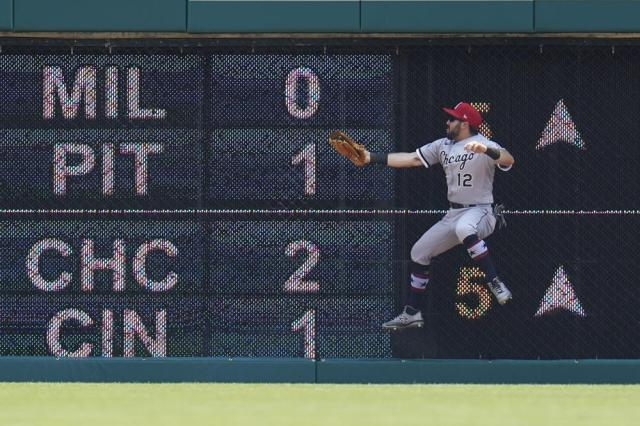 Chicago White Sox right fielder Adam Eaton catches a Detroit Tigers' Eric Haase fly ball in the third inning of a baseball game in Detroit, Sunday, July 4, 2021. (AP Photo/Paul Sancya)