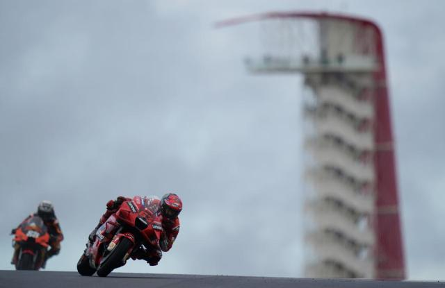 Francesco Bagnaia (63), of Italy, leads Miguel Oliveria (88), of Portugal, through a turn during an open practice session for the MotoGP Grand Prix of the Americas race at the Circuit of the Americas, Friday, Oct. 1, 2021, in Austin, Texas. (AP Photo/Eric Gay)