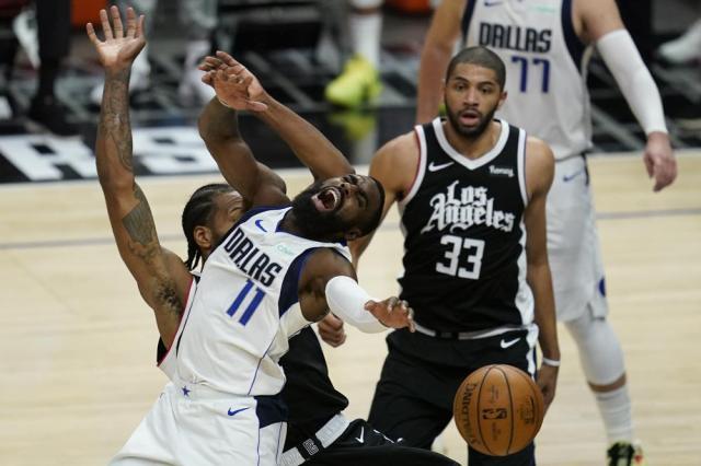 Los Angeles Clippers forward Kawhi Leonard (2) fouls Dallas Mavericks forward Tim Hardaway Jr. (11) during the third quarter of Game 7 of an NBA basketball first-round playoff series Sunday, June 6, 2021, in Los Angeles, Calif. (AP Photo/Ashley Landis)