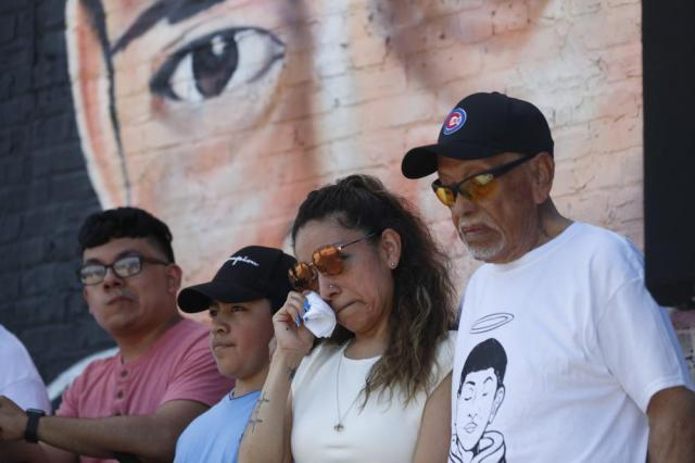 Elizabeth Toledo, center, mother of of police shooting victim 13-year-old Adam Toledo, wipes jer tears during a news conference announcing the opening of Adam's Place Inc., a not-for profit organization aiming to help at-risk youth from Chicago and other Midwestern cities to remain out of trouble, Wednesday, May 26, 2021 in Chicago's West Side. (AP Photo/Shafkat Anowar)