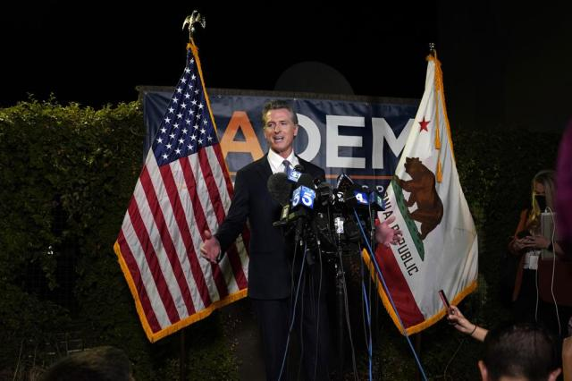 California Gov. Gavin Newsom addresses reporters after beating back the recall attempt that aimed to remove him from office, at the John L. Burton California Democratic Party headquarters in Sacramento, Calif., Tuesday, Sept. 14, 2021. (AP Photo/Rich Pedroncelli)