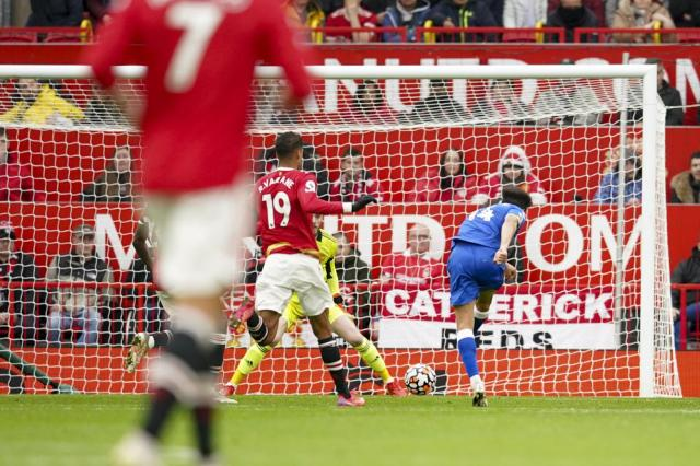 Everton's Andros Townsend, right, scores his side's opening goal during the English Premier League soccer match between Manchester United and Everton, at Old Trafford, Manchester, England, Saturday, Oct. 2, 2021. (AP Photo/Dave Thompson)