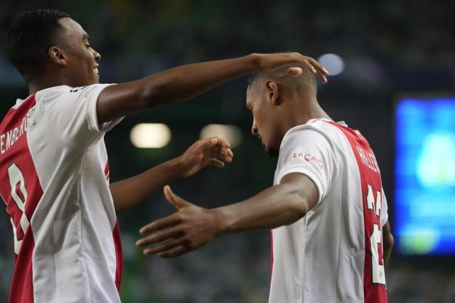 Ajax's Sebastien Haller, right, celebrates after scoring his side's opening goal during a Champions League, Group C soccer match between Sporting CP and Ajax at the Alvalade stadium in Lisbon, Wednesday, Sept. 15, 2021. (AP Photo/Armando Franca)