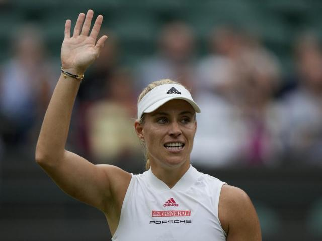 Germany's Angelique Kerber celebrates after defeating Czech Republic's Karolina Muchova during the women's singles quarterfinals match on day eight of the Wimbledon Tennis Championships in London, Tuesday, July 6, 2021.(AP Photo/Alastair Grant)