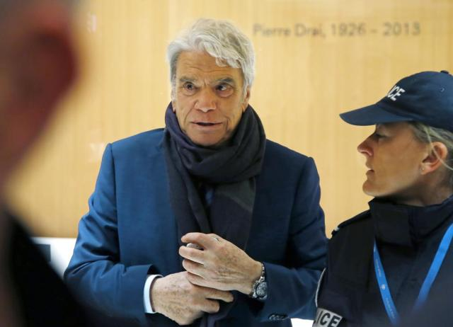 FILE - In this March 13, 2019 file photo, French tycoon Bernard Tapie arrives at Paris court house. Tapie, the charismatic president of French soccer club Marseille during its glory era whose reign was marred by a match-fixing scandal, died Sunday Oct. 3, 2021. He was 78. (AP Photos/Michel Euler, File)