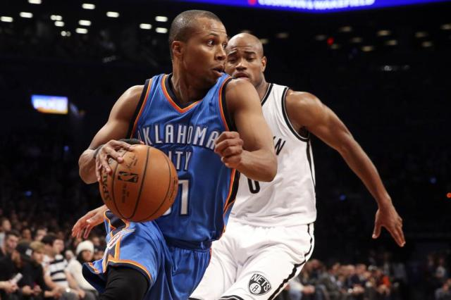FILE - Oklahoma City Thunder guard Sebastian Telfair (31) dribbles past Brooklyn Nets guard Jarrett Jack (0) in the first half of an NBA basketball game in New York, in this Monday, Nov. 3, 2014, file photo. Eighteen former NBA players, including Telfair, have been charged with defrauding the league's health and welfare benefit plan out of about $4 million, according to an indictment Thursday, Oct. 7, 2021. (AP Photo/John Minchillo, File)