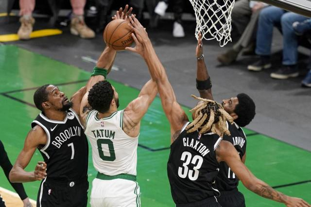 Boston Celtics forward Jayson Tatum (0) has his shot blocked by Brooklyn Nets forwards Kevin Durant (7) and Nicolas Claxton (33) with the help of Nets guard Kyrie Irving (11) in the first half of Game 4 during an NBA basketball first-round playoff series, Sunday, May 30, 2021, in Boston. (AP Photo/Elise Amendola)