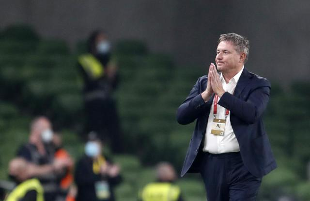 Serbia's coach Dragan Stojkovic reacts during the World Cup 2022 group A qualifying soccer match between Republic of Ireland and Serbia, at Aviva Stadium in Dublin, Tuesday, Sept. 7, 2021. (AP Photo/Peter Morrison)