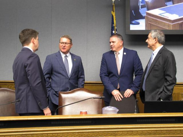From left, economist Stephen Barnes, Senate President Page Cortez, House Speaker Clay Schexnayder and Commissioner of Administration Jay Dardenne, the four members of the Revenue Estimating Conference, talk ahead of the conference's meeting Tuesday, May 18, 2021, in Baton Rouge, La. The conference increased the income forecast for the current and upcoming budget years, giving lawmakers more money to spend. (AP Photo/Melinda Deslatte)