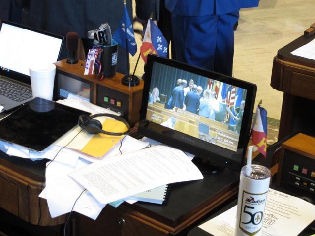 The Louisiana State Senate is shown on a TV at a House lawmaker's desk on the last day of the legislative session, Thursday, June 10, 2021, in Baton Rouge, La. (AP Photo/Melinda Deslatte)