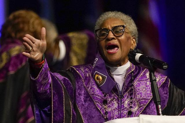 Bishop Anne Byfield, front right, President of the Council of Bishops, speaks during the opening worship service at the African Methodist Episcopal Church conference Tuesday, July 6, 2021, in Orlando, Fla. (AP Photo/John Raoux)