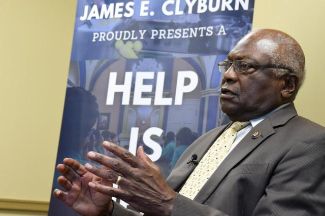 U.S. House Majority Whip Jim Clyburn speaks with reporters ahead of a town hall meeting in his district on Wednesday, July 14, 2021, in Hopkins, S.C. (AP Photo/Meg Kinnard)